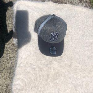 New York Yankees hat.